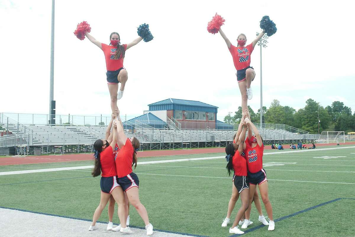 The Dawson High School cheerleaders prepare for the opening of a football season that will be like none before because of the coronavirus pandemic.