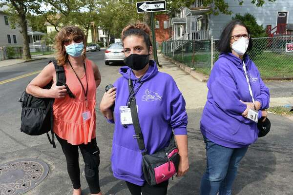 From left, Christine, active sex worker and outreach worker for SWAN (Sex Workers and Allies Network); Jennifer, director of communications and advocacy for SWAN; and Beatrice Cordianni, founder and executive director of SWAN, are photographed on Ferry Street in New Haven on Sept. 18, 2020.