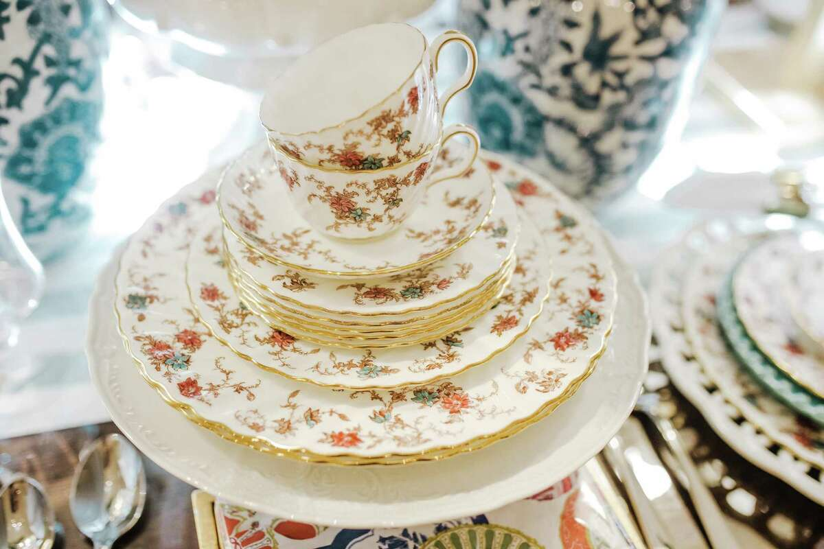 Delicate accessories like vintage teacups are part of the cottage aesthetic.