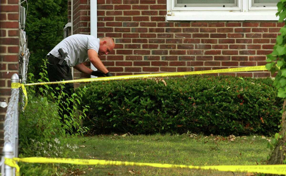 Police investigate at the scene of an apparent homicide at a home on Baird Court in Stratford, Conn., on Friday Sept. 18, 2020.