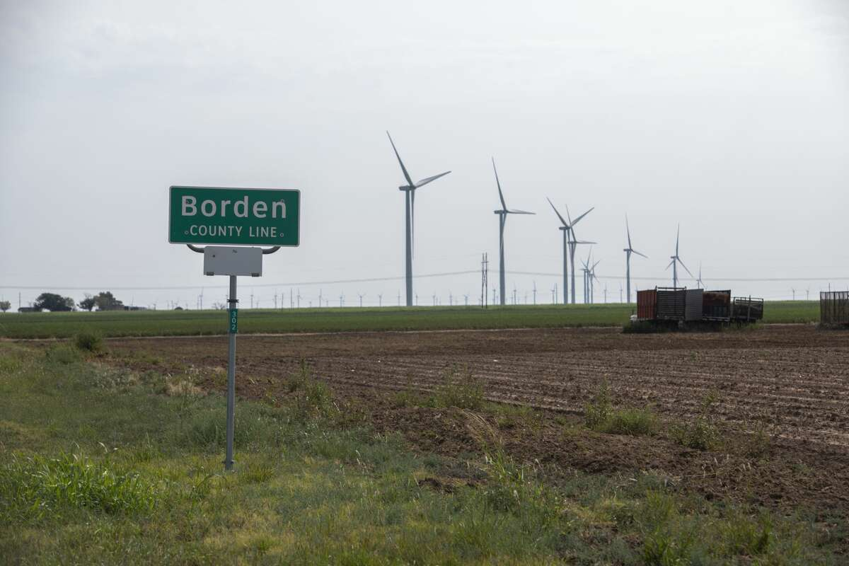 Borden County line with windmills in the background as seen Wednesday, Sept. 16, 2020 along Farm to Market Road 1210 in Borden County. Jacy Lewis/Reporter-Telegram