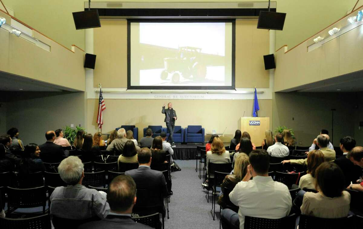 Shawn Nelson, founder and CEO of furniture company Lovesac, gives a speech in UConn-Stamford's Gen Re auditorium, as part of the FastFWD conference during Stamford Innovation Week on Sept. 27, 2019.