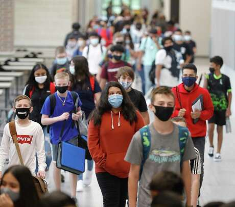 Students wear face masks while walking the hallways of Stockton Junior High School on the first day of in-person school for Conroe ISD, Tuesday, Sept. 8, 2020, in Conroe.