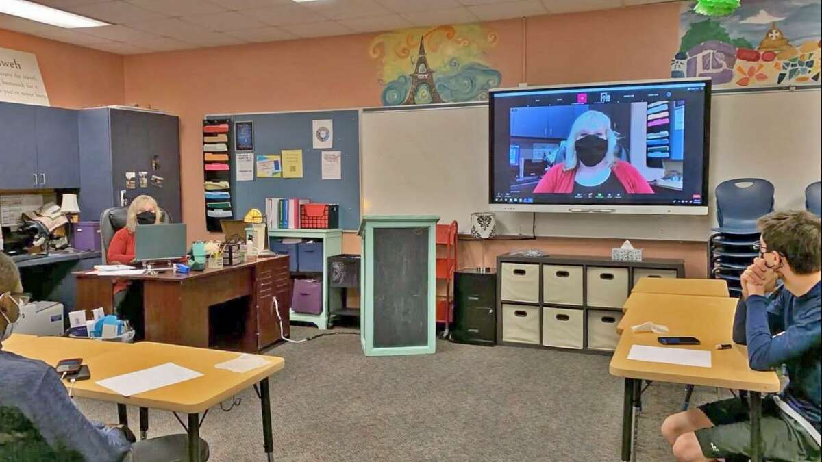 A recent video posted online by Lamar CISD shows a teacher leading students in the classroom along with a group of online students via livestream.