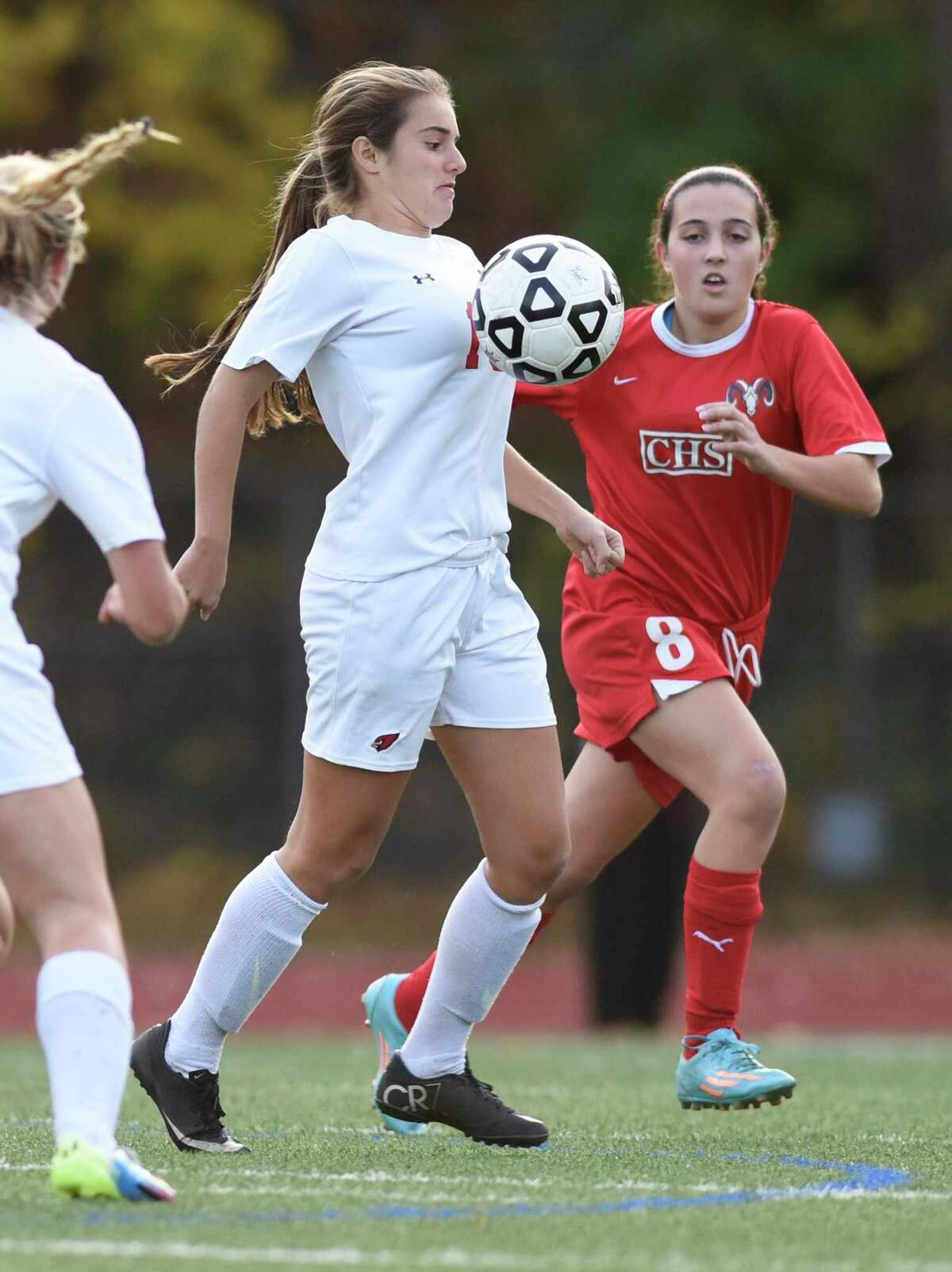 Greenwich's Emily Berzolla, center, controls the ball in front of Cheshire's Kaitlyn Loura in No. 8 Greenwich's 2-1 win over No. 25 Cheshire in the CIAC Class LL high school girls state soccer tournament first-round game at Greenwich High School in Greenwich in 2015. Berzolla, a recent MIT graduate, is one of 30 candidates up for the NCAA Woman of the Year award.