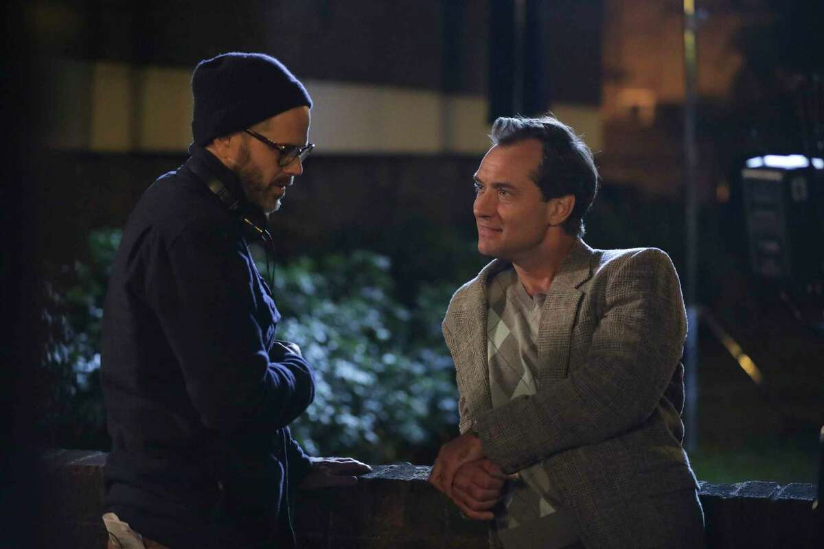 This image released by IFC Films shows Jude Law, right, with filmmaker Sean Durkin on the set of
