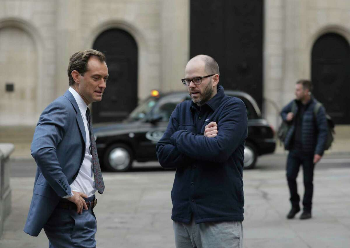 This image released by IFC Films shows Jude Law, left, with filmmaker Sean Durkin on the set of