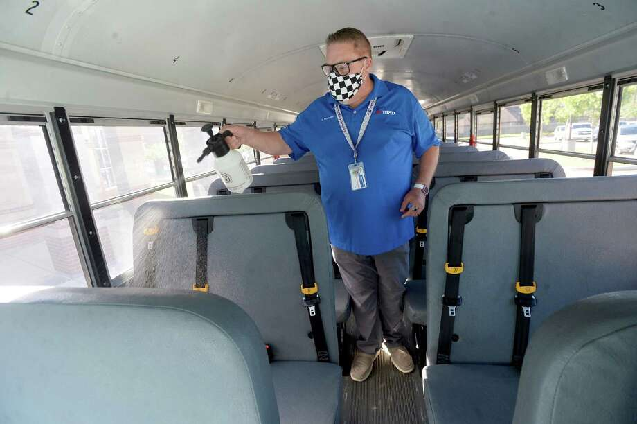 Bennie Huckabay, a BISD driver and route supervisor, shows the cleaning protocols in place after making each run inbetween student pick-ups and drop-offs at Regina - Howell Elementary School, which will join BISD campuses in a rollings start beginning Monday, September 21. Multiple safety protocols for classrooms, school facilities and buses are in place to try and maintain health and safety for students and staff. Photo taken Wednesday, September 16, 2020 Kim Brent/The Enterprise Photo: Kim Brent / Kim Brent/The Enterprise / BEN