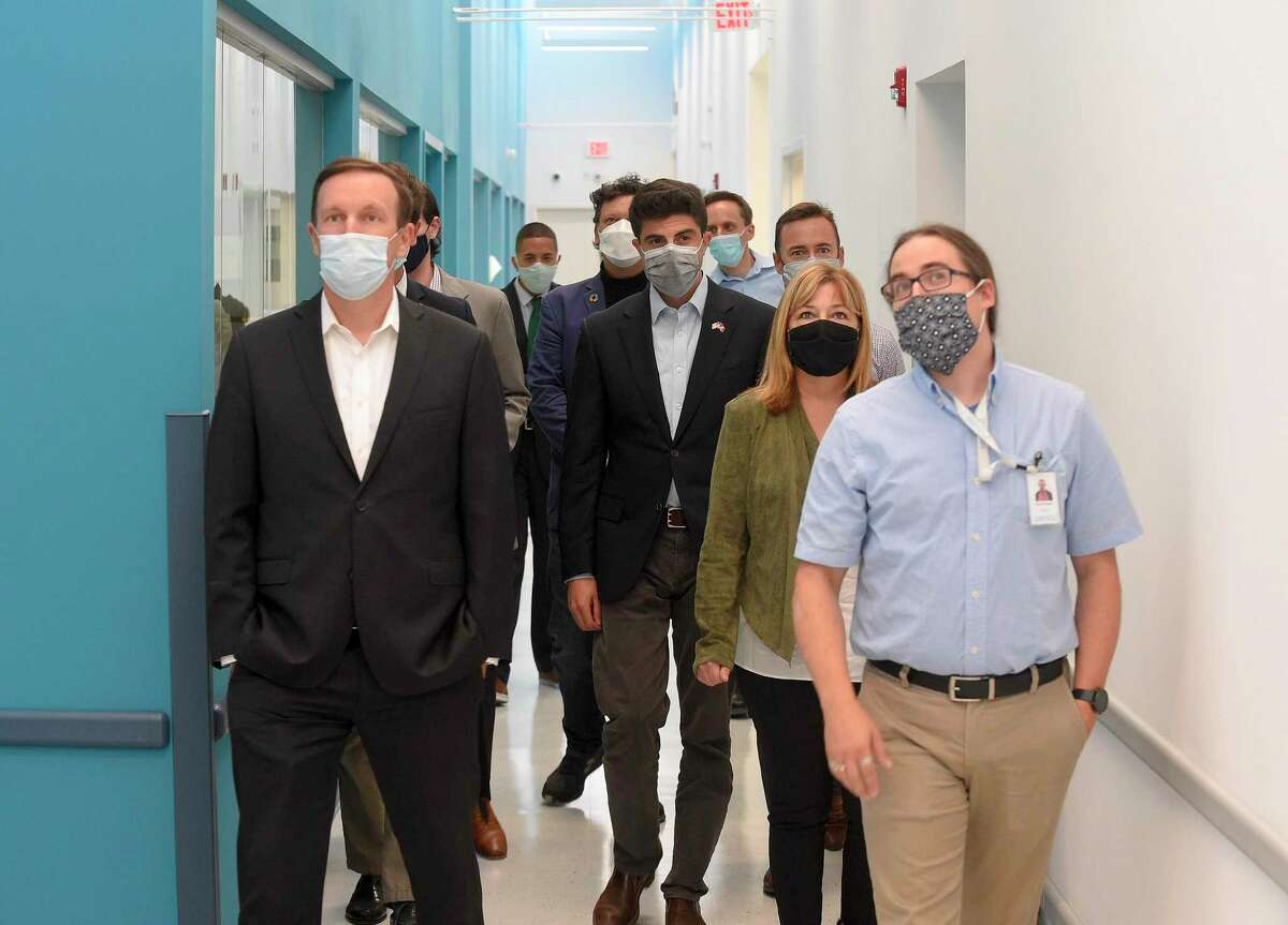 Sen. Chris Murphy, D-Connecticut, left, and other elected officials, tour Sema4's laboratory in Stamford, Conn., with Sema4 vice president of laboratory operations Emmett Higgins, at right, on Sept. 18, 2020.