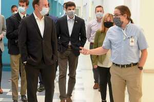 Emmett Higgins, vice president of laboratory operations, at right, leads Sen. Chris Murphy and other electeed officials on a tour Sema4's laboratory at 62 Southfield Ave., in Stamford, Conn., on Sept. 18, 2020.