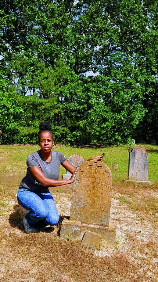Historian Tammy Gibson visits the grave of her great-great-grandfather, Charlie Gilliam, at Martin Grove Cemetery in Vaiden, Mississippi. Photo: Photo Provided