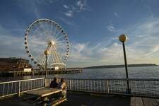 SEATTLE WATERFRONT, SEATTLE, WASHINGTON, UNITED STATES - 2012/08/05: View from Seattle Waterfront Park of the Great Wheel (Ferris wheel) at Seattle's Pier 57, Washington State, USA. (Photo by Wolfgang Kaehler/LightRocket via Getty Images)