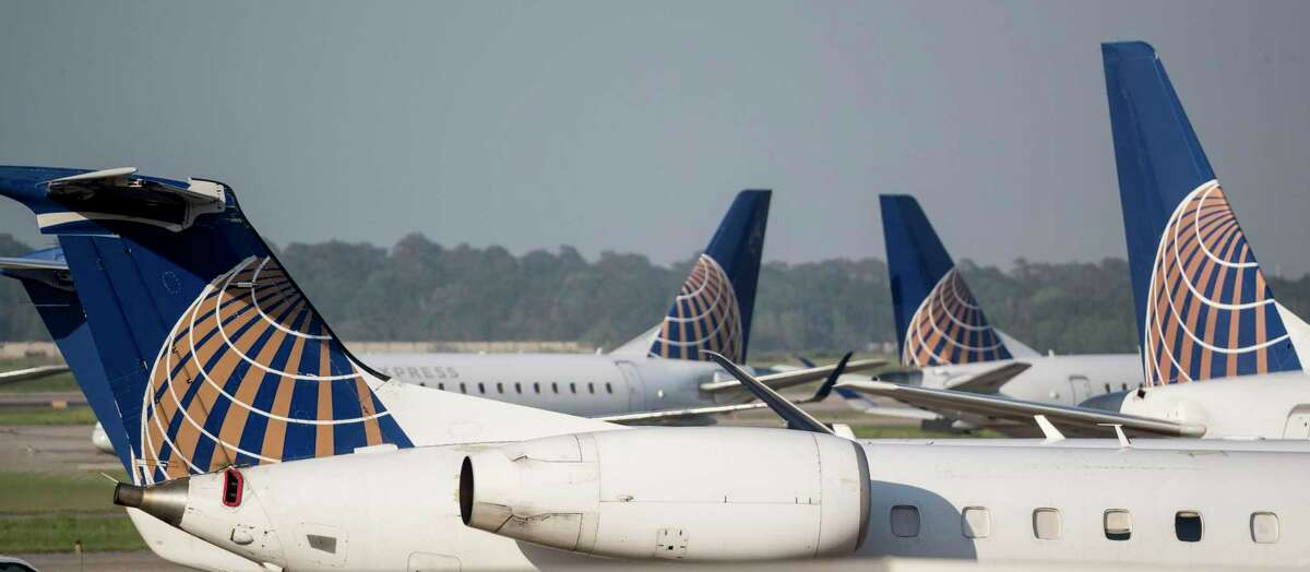 United Express aircraft are parked on the tarmac at George Bush Intercontinental Airport on Wednesday, March 25, 2020 in Spring.