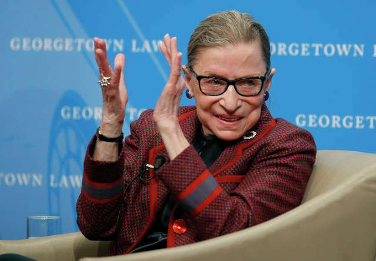 In this April 6, 2018, file photo, Supreme Court Justice Ruth Bader Ginsburg applauds after a performance in her honor after she spoke about her life and work during a discussion at Georgetown Law School in Washington. The Supreme Court says Ginsburg has died of metastatic pancreatic cancer at age 87.