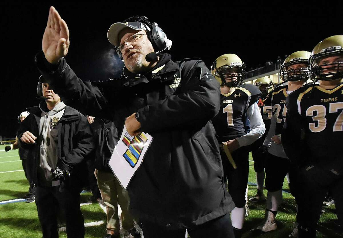 Hand's Steve Filippone coaches the Tigers to a 44-0 win over Guilford, Wednesday, on the eve of Thanksgiving and Filippone's final game of his career, November 23, 2016, at Strong Field at the Surf Club in Madison. (Catherine Avalone/New Haven Register)