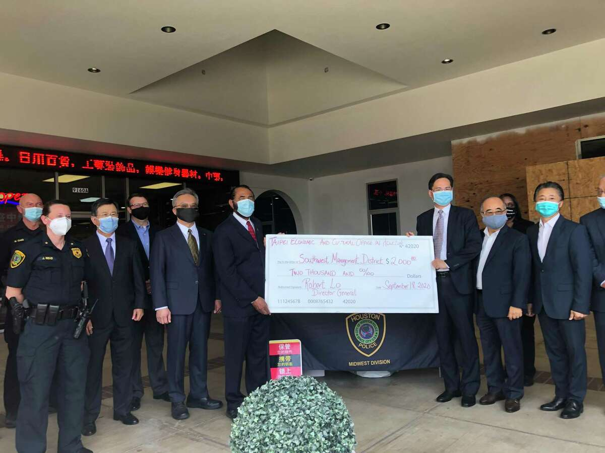 Houston Taipei Economic and Cultural Office Director-General Robert Lo (to the immediate right of the check) presents a $2,000 check to the Southwest Management District to help with public safety at the Sept. 18 celebration the reopening of the Houston Police Department storefront in the Chinatown area.United States Congressman Al Green (to the immediate left of the check) was among many community leaders present at the celebration.