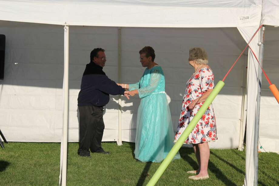 Residents of the Talaski Adult Foster Care home were treated to their own prom on Friday night in the home's backyard. Each of the 12 residents was given a sash as they danced for a few hours. Photo: Robert Creenan/Huron Daily Tribune