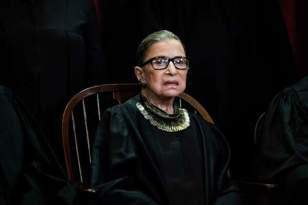 Ruth Bader Ginsburg is pictured in 2018 during a photo session with the Supreme Court.