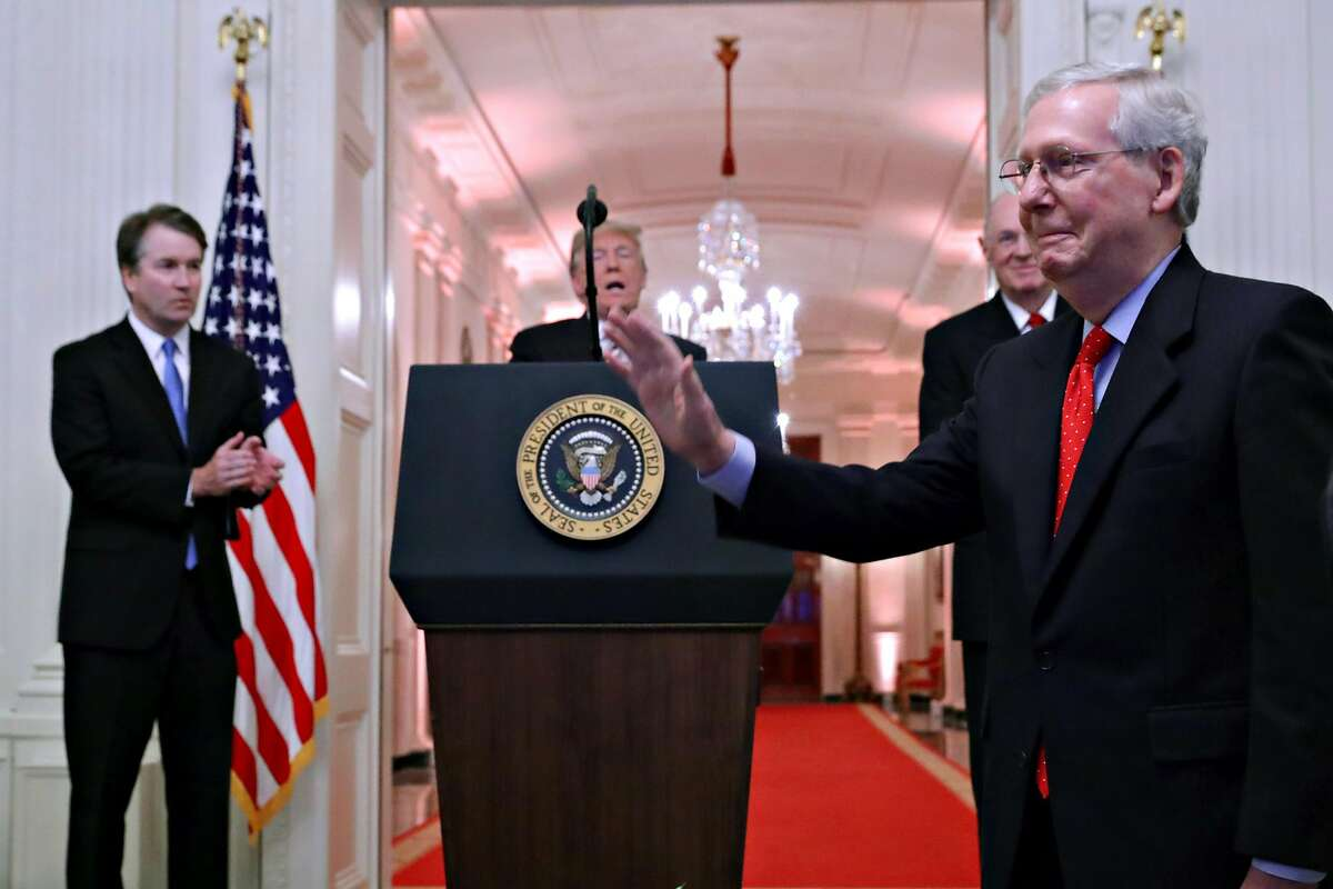 WASHINGTON, DC - OCTOBER 08: Senate Majority Leader Mitch McConnell (R-KY) (R) receives a standing ovation during the ceremonial swearing in of Supreme Court Associate Justice Brett Kavanaugh (L) with U.S. President Donald Trump (C) and retired Justice An
