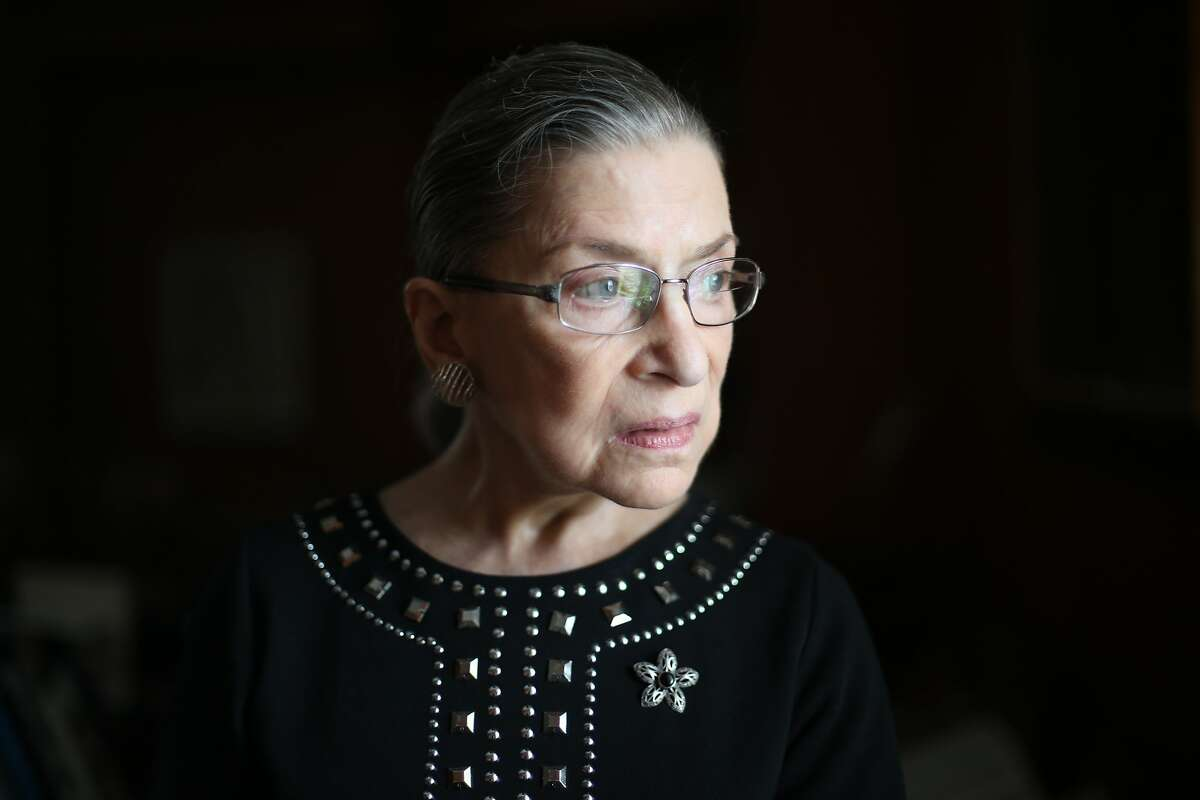 FILE -- Justice Ruth Bader Ginsburg, in her chambers at the Supreme Court in Washington, August 23, 2013. Ginsburg, the second woman to serve on the Supreme Court and a pioneering advocate for women's rights, who in her ninth decade became a much younger generation's unlikely cultural icon, died of complications from metastatic pancreas cancer on Friday, Sept. 18, 2020. She was 87. (Todd Heisler/The New York Times)