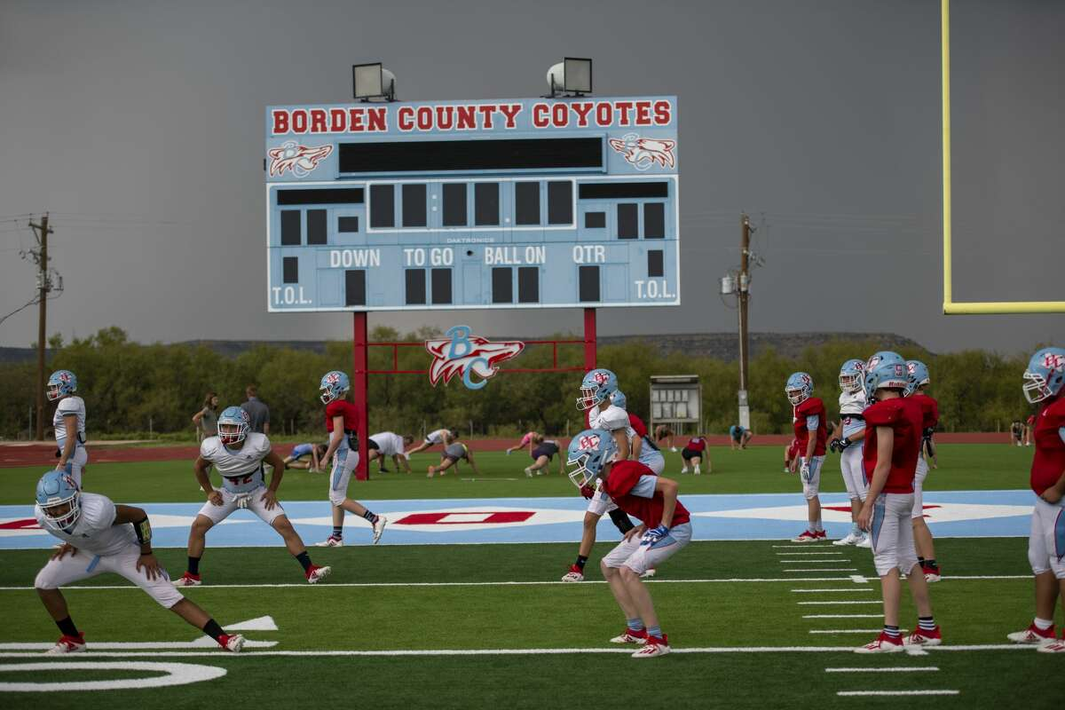 Football players warm up before a storm moves in Wednesday, Sept. 16, 2020 at Coyote Stadium in Gail, Texas. Jacy Lewis/Reporter-Telegram