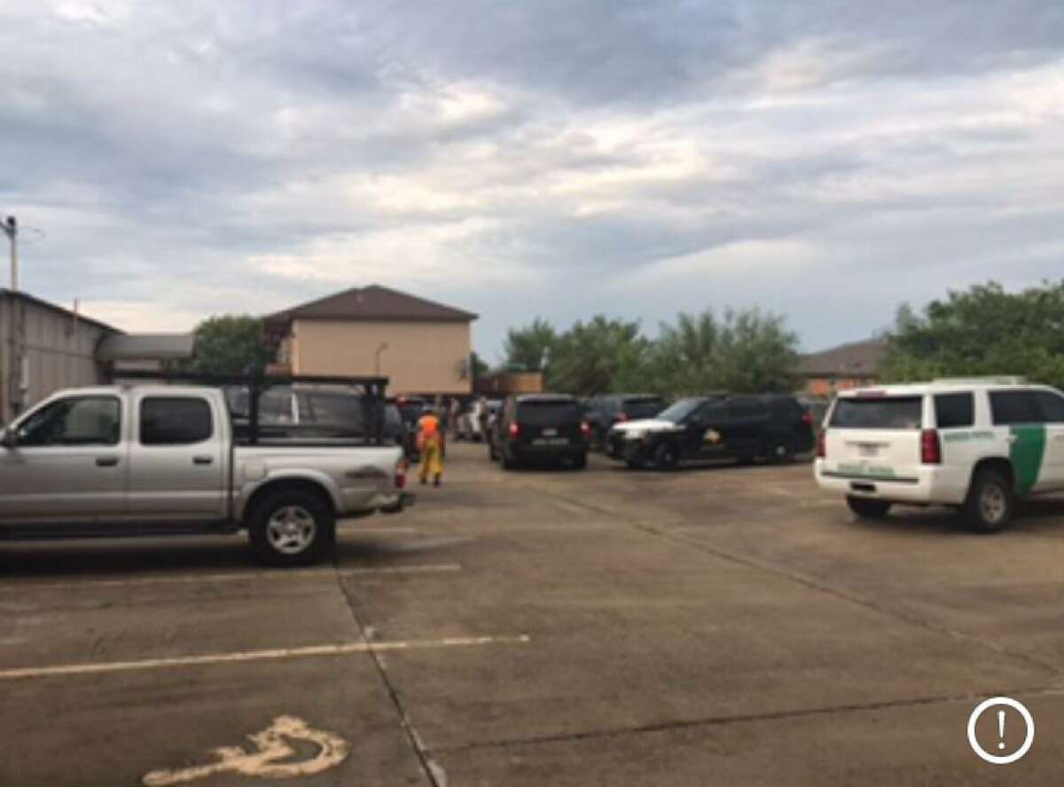 Texas Department of Public Safety troopers and U.S. Border Patrol agents can be seen inside the parking lot of KBNL Radio Manantial in the 1900 block of East Plum Street. Authorities said that a chase ended at that location with one arrest and two immigrants turned over to Border Patrol.