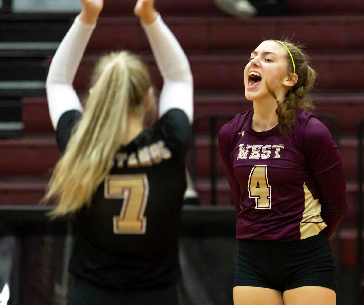 Magnolia West setter Bethany May (4) cheers after her team wins the game during the third set of a non-district volleyball match against Conroe at Magnolia West High School, Friday, Sept. 18, 2020.