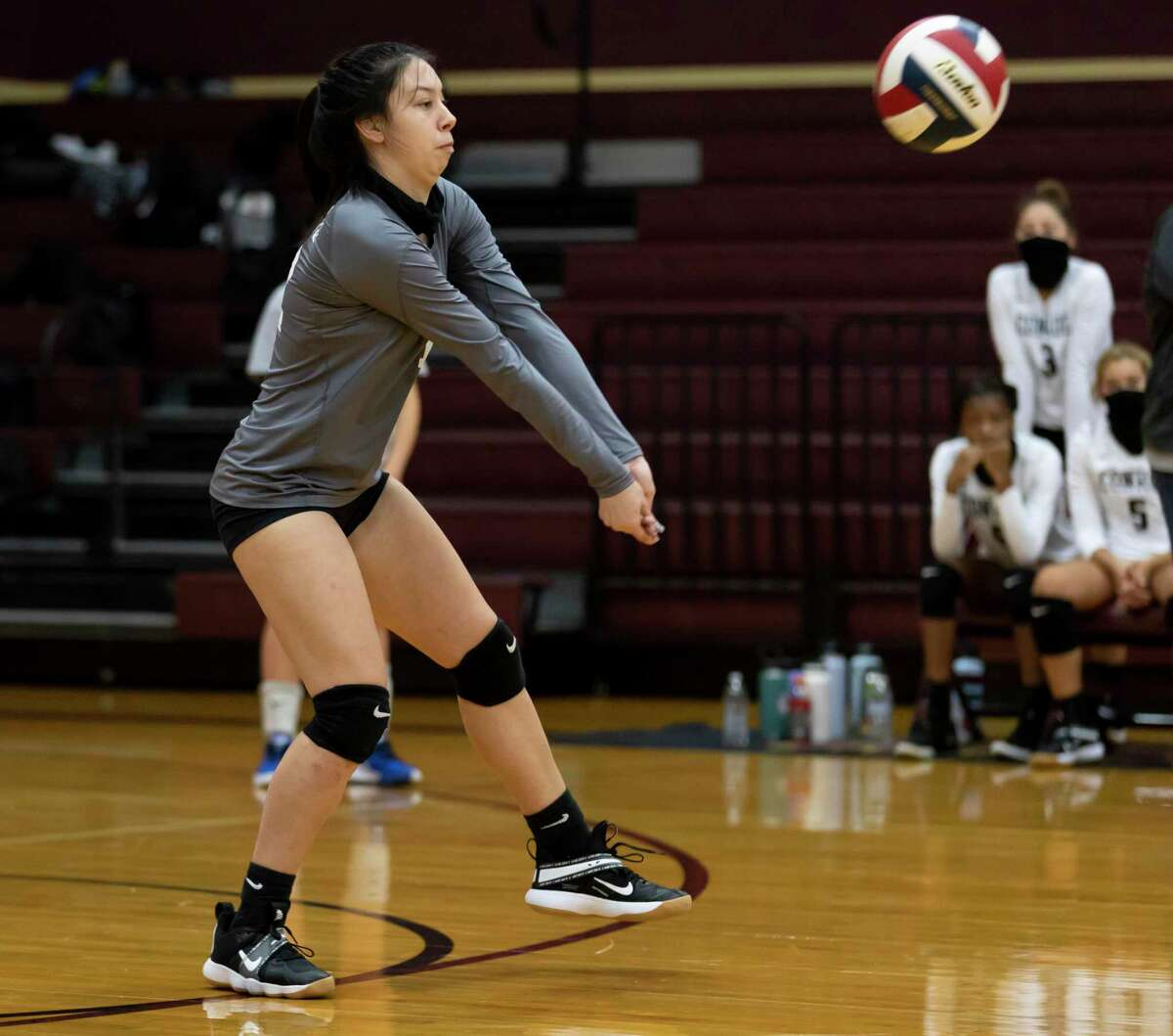 Conroe libero Saege Anzueto (12) returns a serve during the first set of a non-district volleyball match at Magnolia West High School, Friday, Sept. 18, 2020.