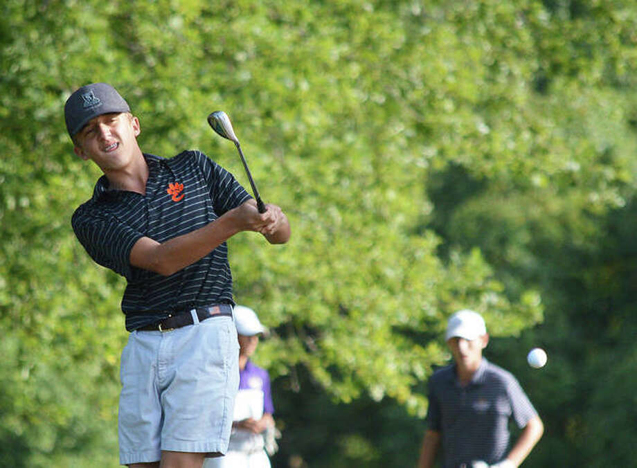 Edwardsville's Bennett Babington hits a chip shot on hole No. 3 at Tamarack Country Club on Friday in the O'Fallon Panther Classic. Photo: Scott Marion/The Intelligencer