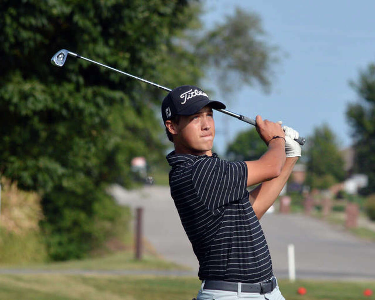 Edwardsville's Tyler Janson hits a tee shot on hole No. 15 at Tamarack Country Club on Friday in the O'Fallon Panther Classic.
