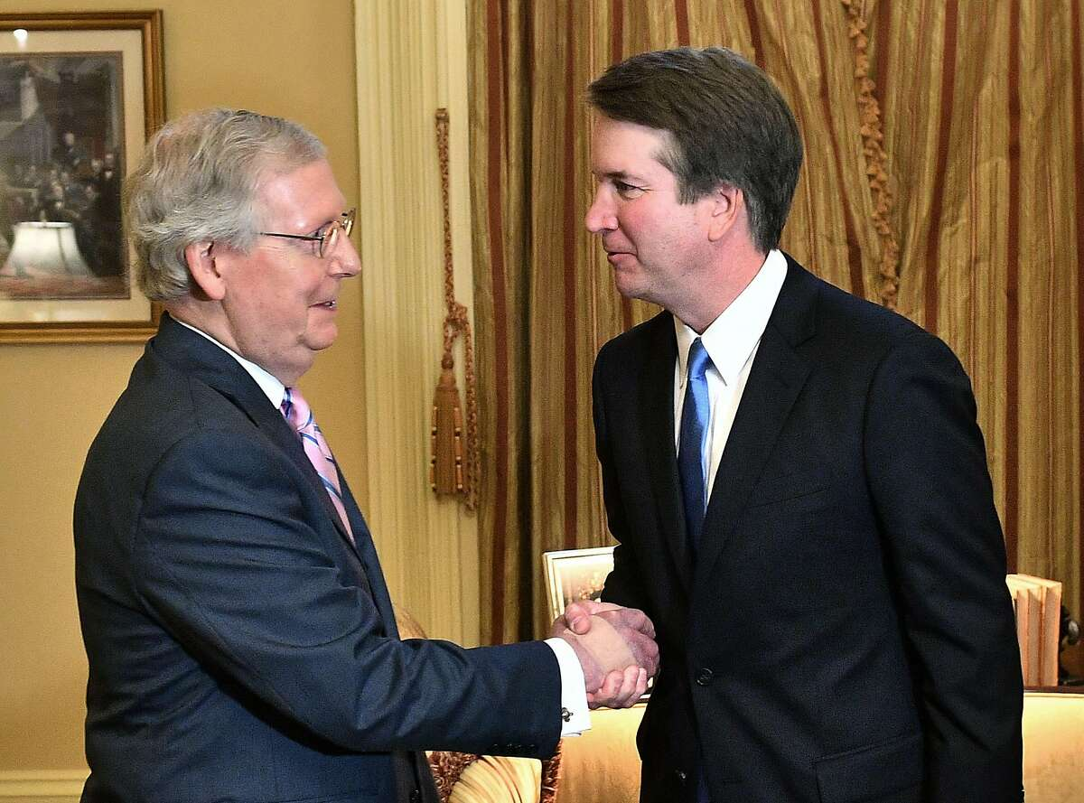 US Senate Majority Leader Mitch McConnell (L) welcomes Supreme Court associate justice nominee Brett Kavanaugh in McConnell's office at the US Capitol in Washington, DC. on July 10, 2018. (Photo by MANDEL NGAN / AFP) (Photo credit should read MANDEL NGAN/AFP via Getty Images)