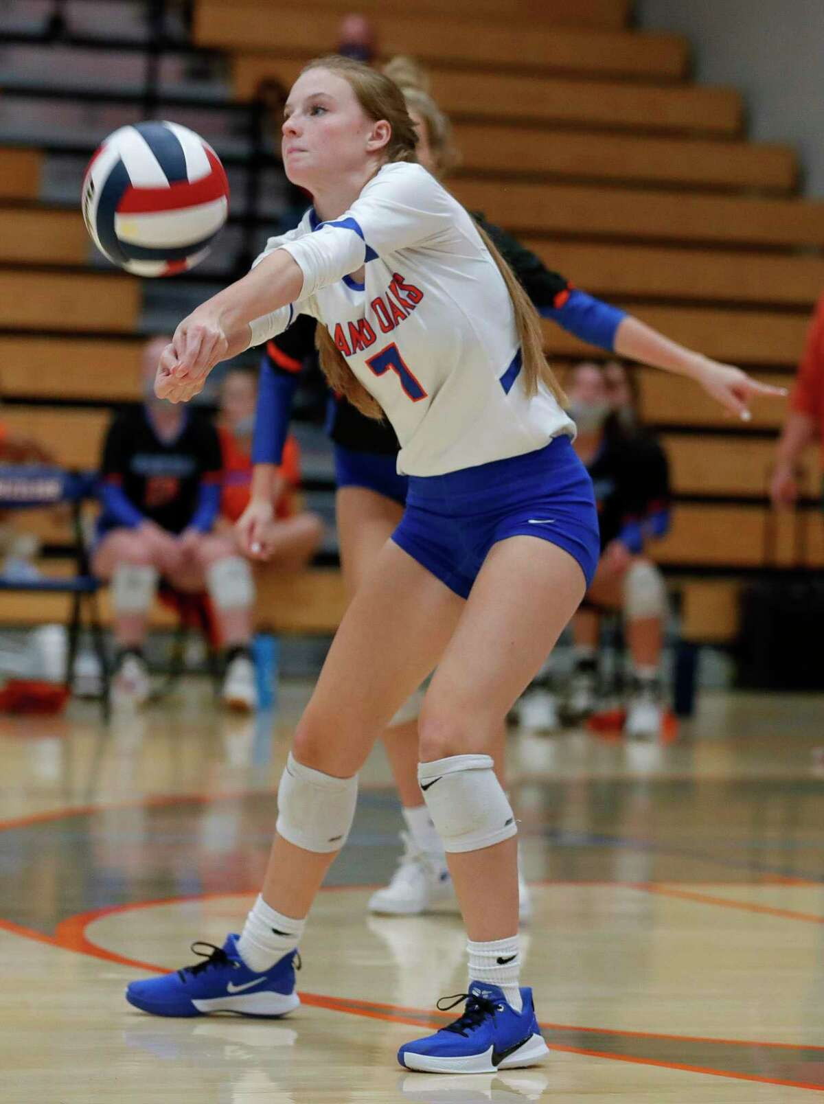Grand Oaks libero Ava Terry (7) returns a serve during the first set of a non-district high school volleyball match at Grand Oaks High School, Friday, Sept. 18, 2020, in Spring.