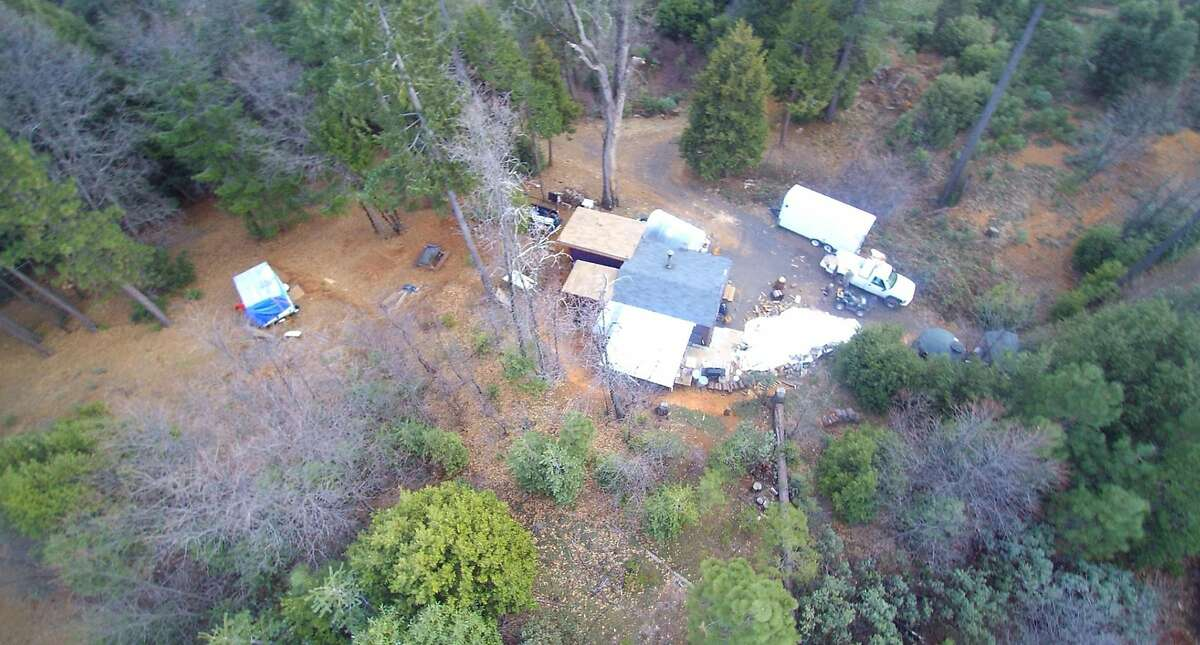 The drone image of Chris Woolf's home on Shute Mountain Road in Brush Creek, Calif. Mr. Woolf, 50, a former Navy medic and Burning man ranger escaped from his home in Butte County at the last possible second as 200 foot flames from the North Complex fire descended on his cabin in September 2020.