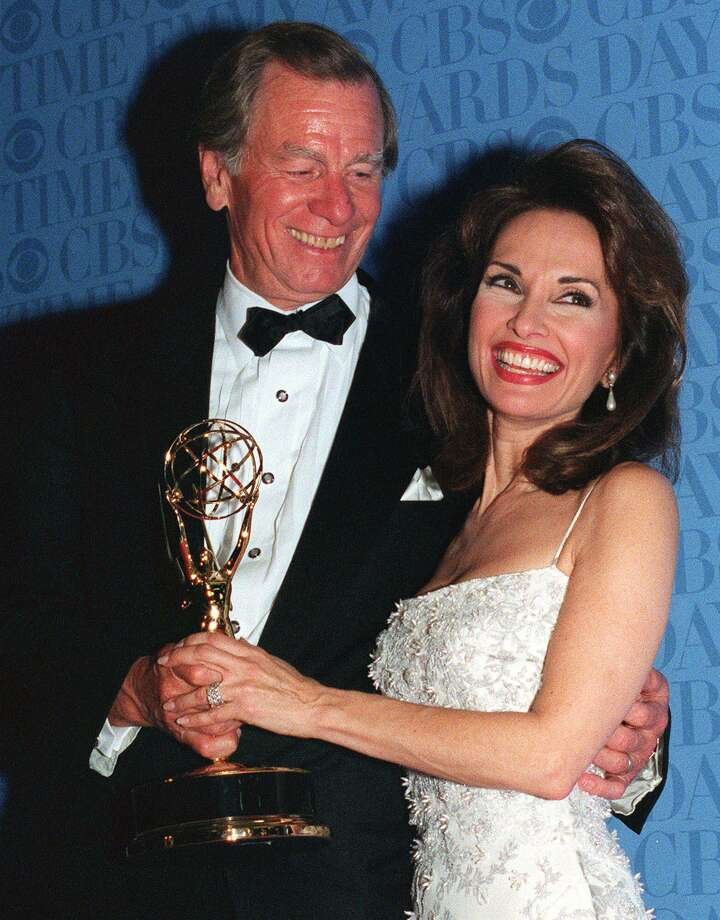 A triumphant Susan Lucci and her husband Helmut Huber hold the Daytime Emmy statue she waited 19 years to receive, during the Daytime Emmy Awards in New York, on Friday, May 21, 1999. Lucci won Best Actress in a Drama Series for her role as Erica Kane on ABC's 'All My Children.' Photo: MITCH JACOBSON / AP Photo / AP