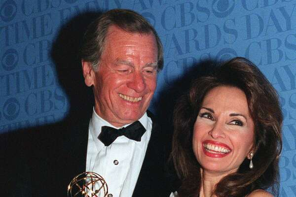 A triumphant Susan Lucci and her husband Helmut Huber hold the Daytime Emmy statue she waited 19 years to receive, during the Daytime Emmy Awards in New York, on Friday, May 21, 1999. Lucci won Best Actress in a Drama Series for her role as Erica Kane on ABC's 'All My Children.'
