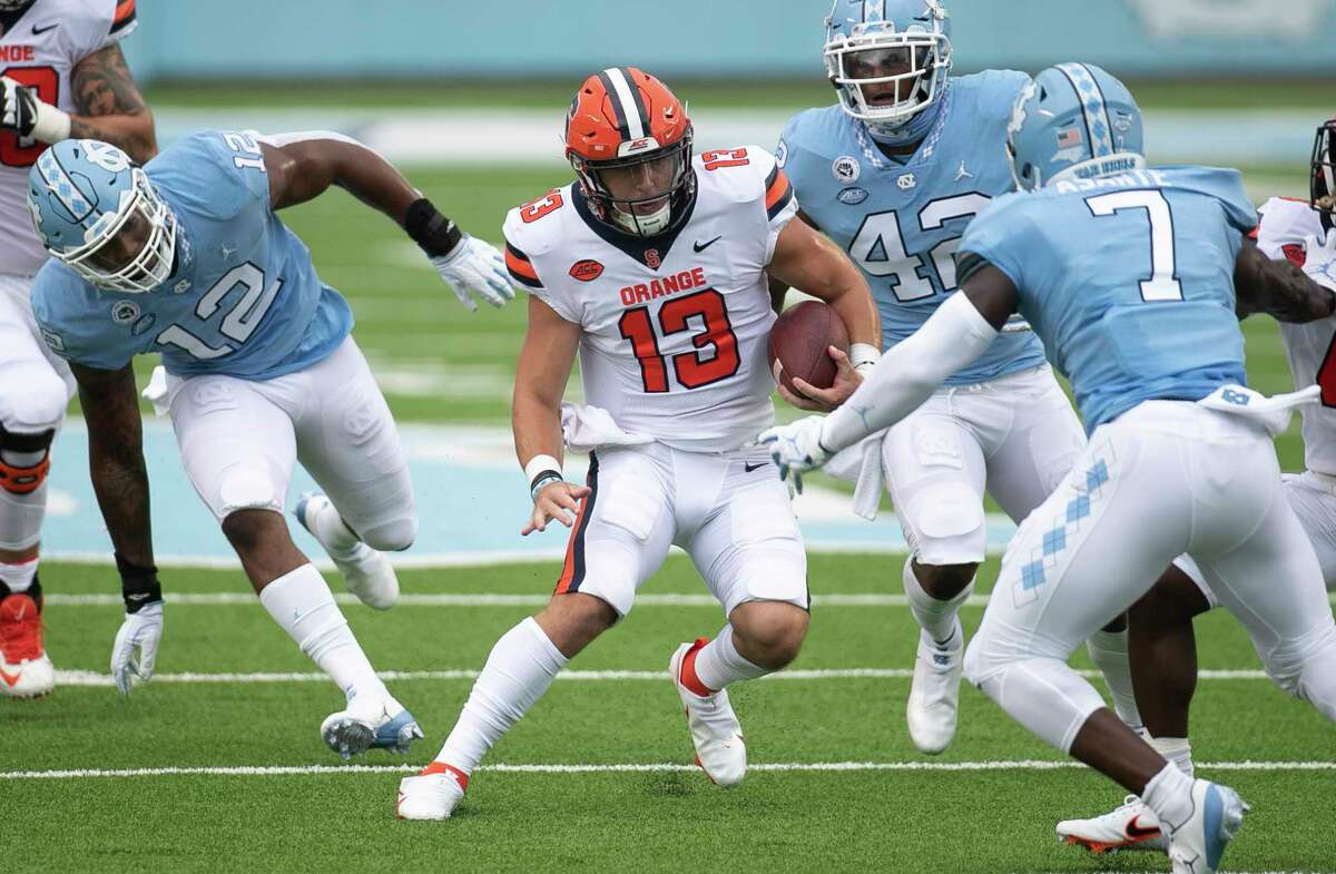 Syracuse quarterback Tommy DeVito (13) looks for running room against North Carolina's Eugene Asanti (7) during the second quarter of an NCAA college football game Saturday, Sept. 12, 2020 in Chapel Hill, N.C. (Robert Willett/The News & Observer via AP, Pool)
