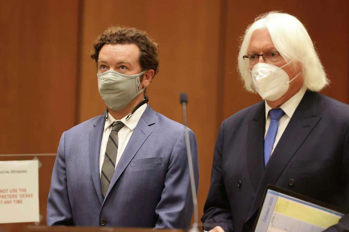 Actor Danny Masterson, left, stands with his attorney, Thomas Mesereau as he is arraigned on rape charges at Los Angeles Superior Court, in Los Angeles, Calif. on Friday, Sept. 18, 2020. (Lucy Nicholson/Pool Photo via AP)