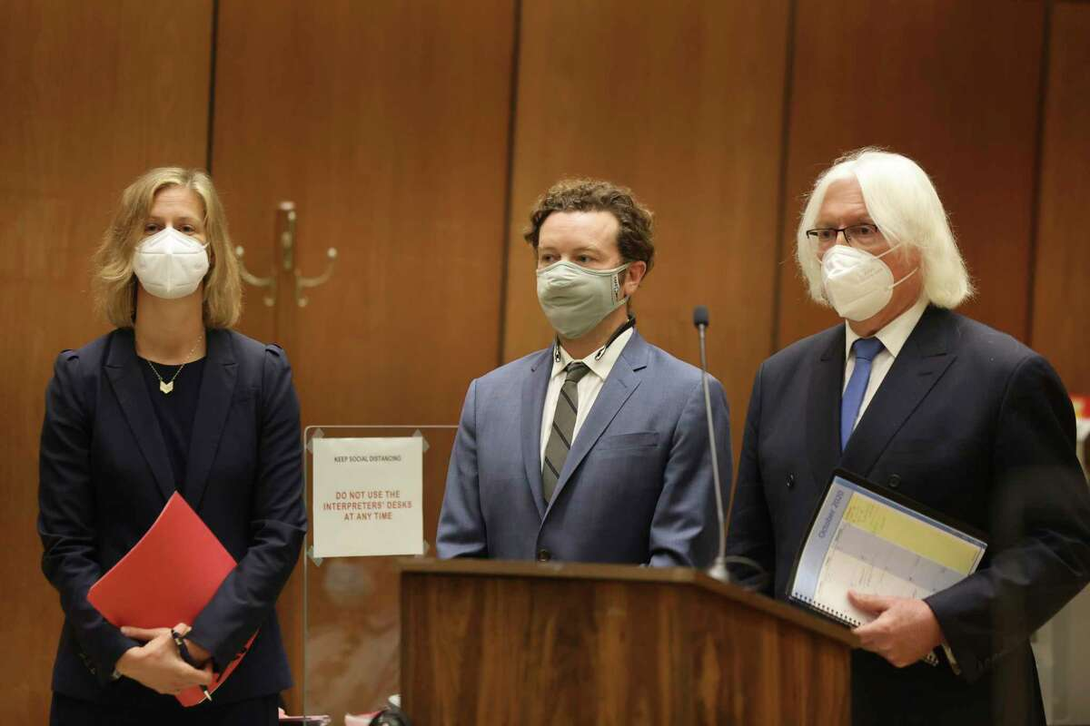 Actor Danny Masterson, center, stands with his attorneys, Thomas Mesereau, right, and Sharon Appelbaum as he is arraigned on rape charges in Los Angeles Superior Court in Los Angeles, Calif. on Friday, Sept. 18, 2020. (Lucy Nicholson/Pool Photo via AP)