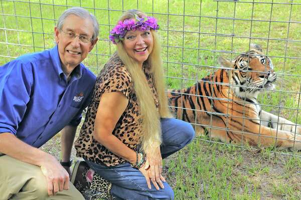 A photo provided by ThinkFactory Media shows Carole and Howard Baskin of Big Cat Rescue in Tampa, Fla. A new, unscripted series will follow the Baskins as a€œthey work to exposea€ animal abuse, a production company said. (ThinkFactory Media via The New York Times) -- NO SALES; FOR EDITORIAL USE ONLY WITH NYT STORY TV TIGER BASKIN BY CHRISTINA MORALES FOR SEPT. 17, 2020. ALL OTHER USE PROHIBITED. --