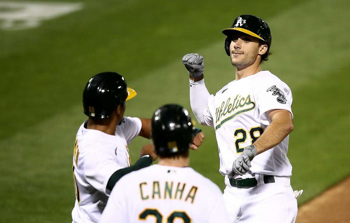 OAKLAND, CALIFORNIA - SEPTEMBER 18: Matt Olson #28 of the Oakland Athletics is congratulated by Marcus Semien #10 after he hit a three-run home run off of Logan Webb #62 of the San Francisco Giants in the third inning at RingCentral Coliseum on September 18, 2020 in Oakland, California. (Photo by Ezra Shaw/Getty Images)