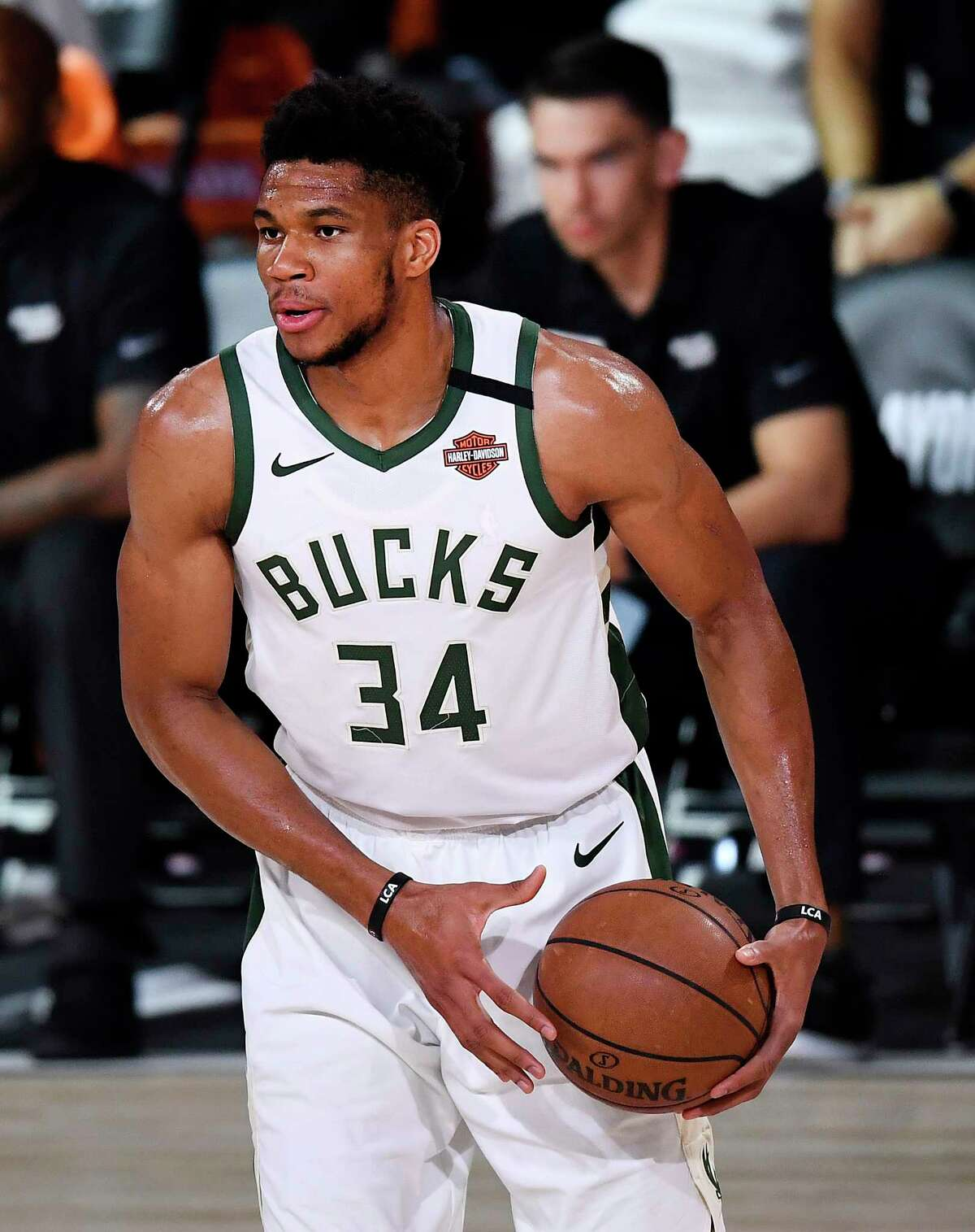 LAKE BUENA VISTA, FLORIDA - SEPTEMBER 06: Giannis Antetokounmpo #34 of the Milwaukee Bucks handles the ball during the first quarter against the Miami Heat in Game Four of the Eastern Conference Second Round during the 2020 NBA Playoffs at AdventHealth Arena at the ESPN Wide World Of Sports Complex on September 06, 2020 in Lake Buena Vista, Florida. NOTE TO USER: User expressly acknowledges and agrees that, by downloading and or using this photograph, User is consenting to the terms and conditions of the Getty Images License Agreement. (Photo by Douglas P. DeFelice/Getty Images)