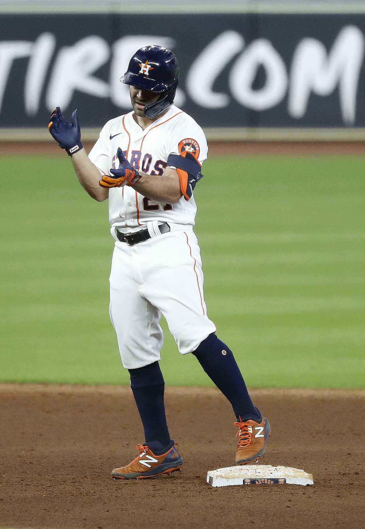 Houston Astros Jose Altuve (27) stands on second base after hitting a double off of Arizona Diamondbacks relief pitcher Hector Rondon during the seventh inning of an MLB baseball game at Minute Maid Park, Friday, September 18, 2020, in Houston.