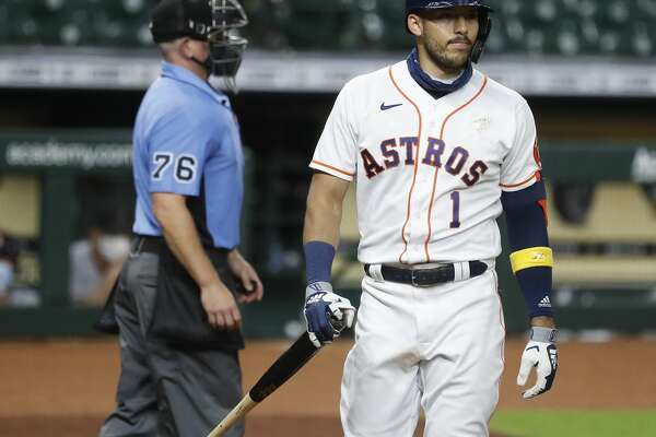 Houston Astros shortstop Carlos Correa (1) reacts after he struck out against Arizona Diamondbacks Stefan Crichton during the ninth inning of an MLB baseball game at Minute Maid Park, Friday, September 18, 2020, in Houston. Astros lost to the Arizona Diamondbacks 6-3.