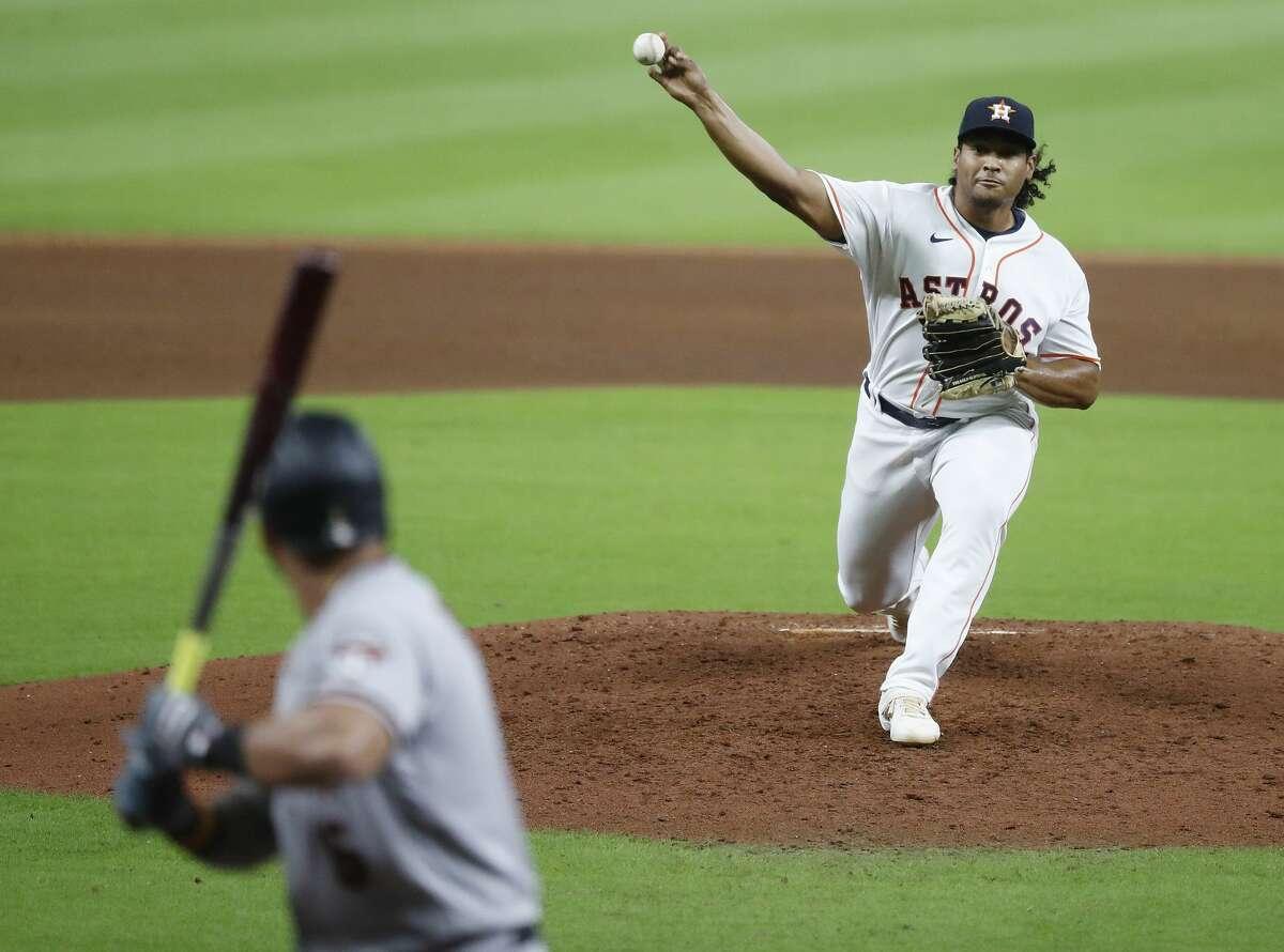 Houston's Luis Garcia (77) pitches to Arizona Diamondbacks David Peralta during the sixth inning of an MLB baseball game at Minute Maid Park, Friday, September 18, 2020, in Houston.