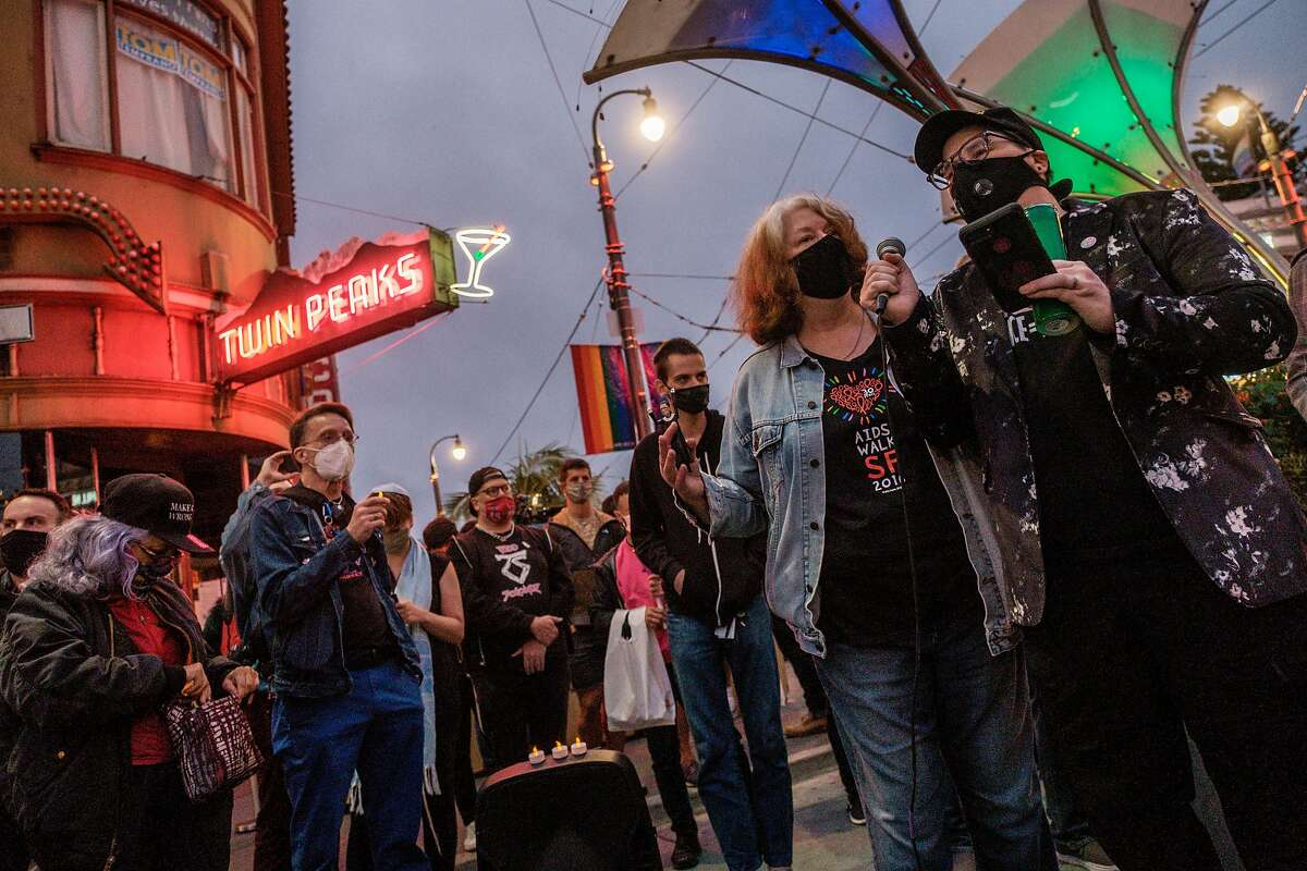 People attend a vigil for Supreme Court Justice Ruth Bader Ginsburg in the Castro, just hours after her death was announced in San Francisco on Friday, September 18, 2020. Bader Ginsburg, has died at the age of 87 after a battle with pancreatic cancer.