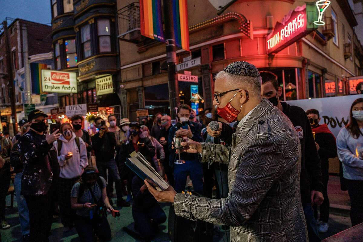 A jewish prayer is given during a vigil for Supreme Court Justice Ruth Bader Ginsburg in the Castro, just hours after her death was announced in San Francisco on Friday, September 18, 2020. Bader Ginsburg, has died at the age of 87 after a battle with pancreatic cancer.