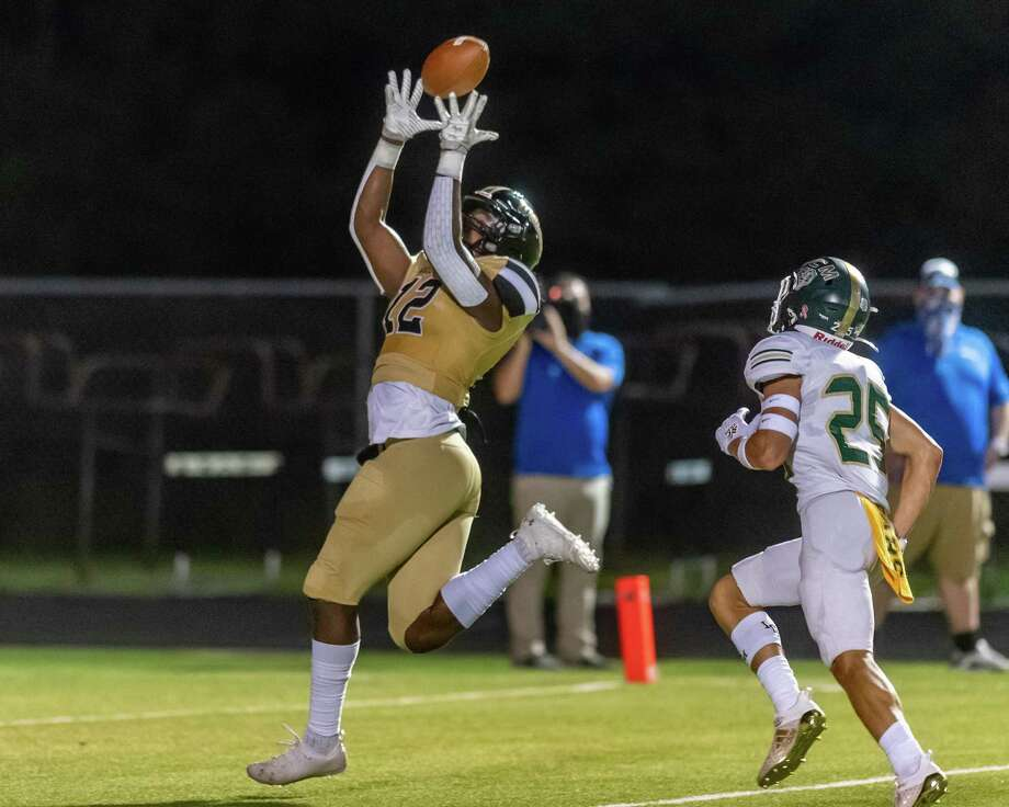 Woodville's Jacorey Hyder (12) pulls in a touchdown pass in the first half as the Woodville Eagles and the Little Cypress-Mauriceville Bears faced off on Friday night in Woodville. Photo made on September 18, 2020.  Fran Ruchalski/The Enterprise Photo: Fran Ruchalski / Fran Ruchalski/The Enterprise / © 2020 The Beaumont Enterprise