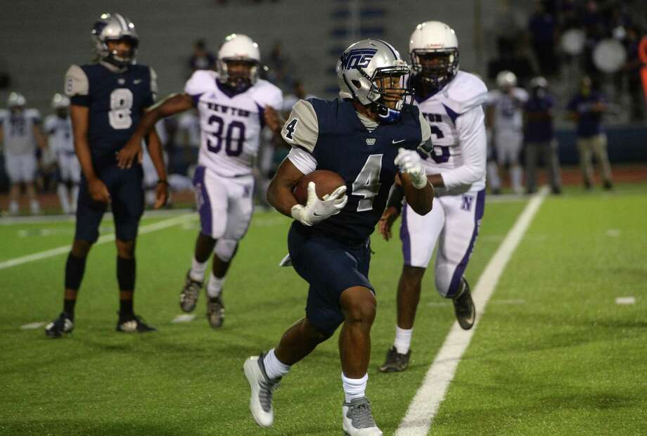 West Orange - Stark's Elijah Gales runs the ball up the side  as Newton's defense pursues during their match-up Friday night in West Orange. Photo taken Friday, September 18, 2020 Kim Brent/The Enterprise Photo: Kim Brent / Kim Brent / Staff Photographer / BEN