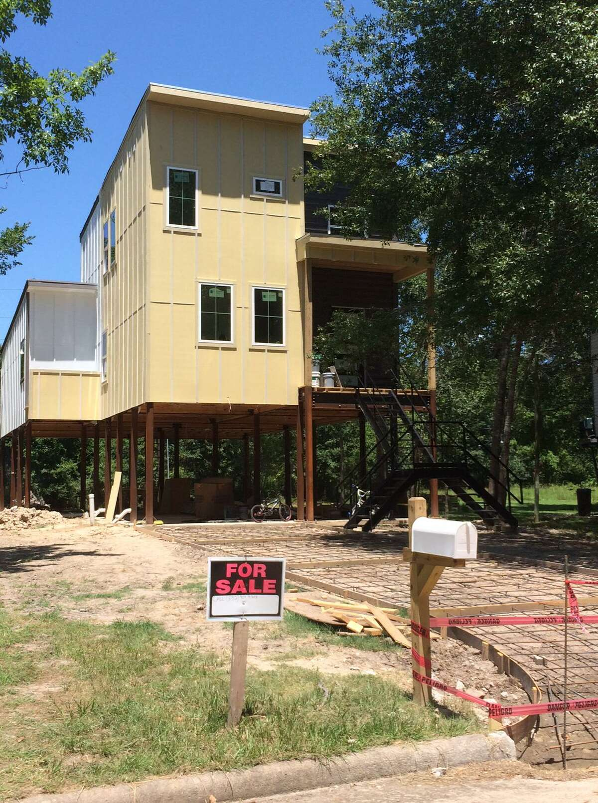 This home was being erected by a private builder in Saracen Park on Cypress Creek. The area is dotted with vacant lots where the homes were bought out by FEMA to escape repeated flooding. Residents are angry that the home is being built in the floodway--not the flood plain, the floodway.