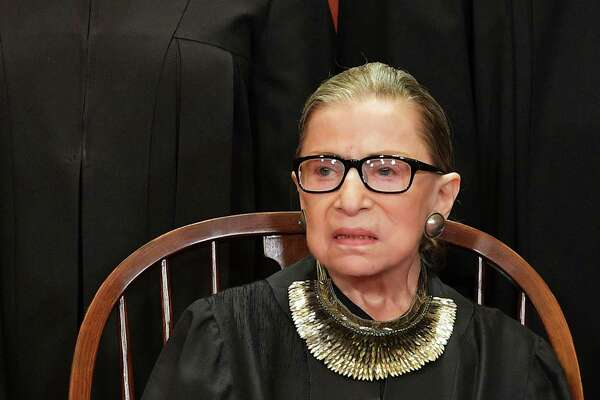 "(FILES) In this file photo taken on November 30, 2018 Associate Justice Ruth Bader Ginsburg poses for the official photo at the Supreme Court in Washington, DC. - Progressive icon and doyenne of the US Supreme Court, Ruth Bader Ginsburg, has died at the age of 87 after a battle with pancreatic cancer, the court announced on September 18, 2020. Ginsburg, affectionately known as the Notorious RBG, passed away ""this evening surrounded by her family at her home in Washington, DC,"" the court said in a statement."